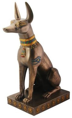 Anubis Statue  12.5 inches high    Larger, hand polished cold cast bronze statue of the Egyptian Jackal God of the Dead Anubis. Symbols and heiroglyphs painted all around the body of the jackal, who sports a golden colored collar. Reasonably priced artwork that's a high quality addition to any decor. U$85