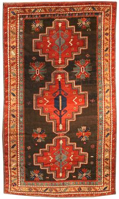 An early 20th century Kazak antique rug, the chocolate brown field with abstract polychrome flowerheads around three linked red stepped medallions containing hooked and angular floral motifs within a series of floral motif stripes. Watch full size video of A Kazak rug, Circa 1900, ID BB3912 - Video