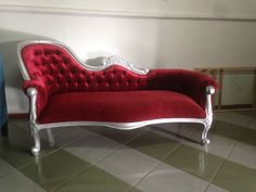 Red velvet sofa with silver finishing