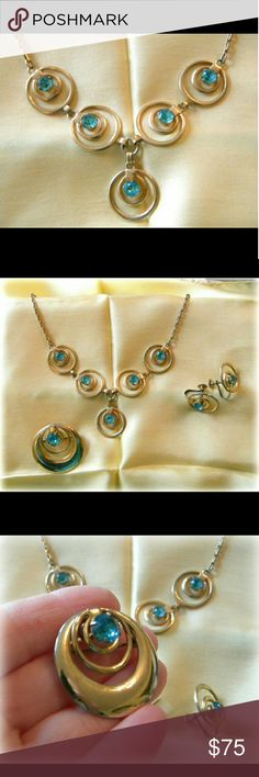 """Vintage Blue Zircon Rosy Gold Trifecta Necklace, earrings + brooch are unmarked. Prong set stones were called blue Zircon when these were made, 1950's to 60's. Probably rolled gold, with a rose hue. Necklace is 17"""". Movie Star Stuff! Earrings are screwback. Brooch can also be worn as Necklace as it has movable bale. Vintage  Jewelry"""