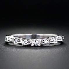 This is a perfect wedding band for Art Deco or vintage diamond engagement rings. The slightly contoured band features five round diamonds set in geometric settings which are finished with milgrain details. The slight contouring provides a snug fit for mos Platinum Diamond Wedding Band, Diamond Wedding Rings, Diamond Bands, Diamond Engagement Rings, Engagement Bands, Wedding Band Sets, Wedding Rings Vintage, Vintage Engagement Rings, Wedding Jewelry