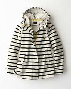 The perfect antidote to rainy days, this sunny, gloom-fighting style includes nautical stripes, oversized buttons, delightful yellow accents, and floral lining.