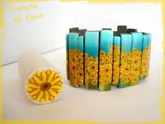 Beautiful tutorial for a polymer clay sunflower cane. It's in French, but can kind of be picked apart from the images if you don't want to translate. (In which case knowledge of Bettina Welker's Retro Pixel Blend cane is helpful, 'cause they adapt it for part of the flower.)