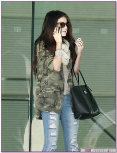Selena Gomez is one stylish starlet and the young actress showed off her fab style today as she stopped by her agency this afternoon.  Selena wore a pair of overly ripped skinny jeans, a camo jacket, scarf and pair of heels with her hair long and wavy as she visited the CAA offices in Century City.