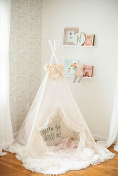 A whimsical, bohemian girl's nursery with removable wallpaper and glam accents…
