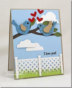 handmade card ... cute garden scene made of die cuts ... two birds on a branch ... little hearts ... flat bottomed clouds ... white lattice fence ... green grass ... sweet!! ... My Favorite Things ...