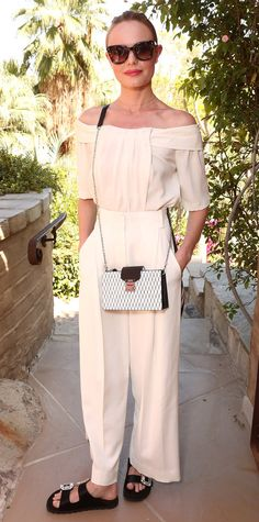 Longtime Coachella lover, Kate Bosworth opted to not go boho this year and went with a super chic cream track pant and matching off the shoulder top. To complete her look she paired her ensemble with black Roger Vivier slides and a mini cross-body bag by MCM Worldwide.