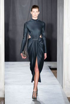 Pin for Later: 43 Reasons Why We Can't Wait For Jason Wu's Spring Collection Jason Wu Fall 2014 Surprising flashes of skin made for an edgy contrast to more elegant accessories.