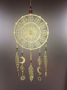 Dream catcher, timber & glass beads.