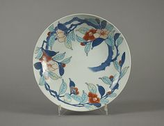 Dish with Camellia Design Period: Edo period (1615–1868) Date: early 18th century Culture: Japan Medium: Porcelain with overglaze enamels (Hizen ware, Nabeshima type) Dimensions: H. 2 3/8 in. (6 cm); Diam. 8 1/8 in. (20.6 cm) Classification: Ceramic