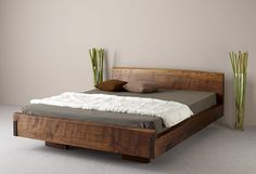"A rustic platform bed...I want one! Similar to this, but with a higher headboard and wider sides, where the mattress sits on top. I'm putting it on someone's ""honey-do"" list!"