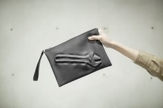 VF MATTE (M) - Vacuum formed clutch with industrial tools shape on the surface. With a removable hand strap. www.pomch.com