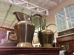 large brass jugs: available for purchase at Uncommon Market Dallas, 100 Riveredge Drive, Dallas, Texas 75207; call us @ 214-871-2775 if you would like to put this item on a 2 day HOLD.