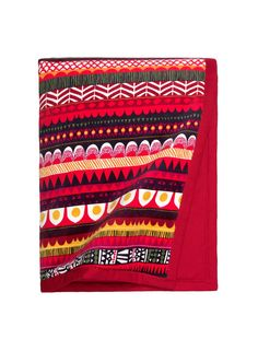 Marimekko Raanu-torkkupeitto.  I can imagine being curled up in this quilt, sitting by the Christmas tree, watching the candles on the tree burn and looking at a pile of paper from the unwrapped gifts.