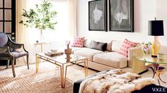 Neutral tones and feminine accents in Karlie Kloss' living room designed by Nate Berkus