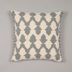 These classic designer cushions are based on a traditional Moroccan tile motif, which has been simplified and scaled up to great effect.  The crewel embroidery technique follows the contour of the design and emphasises the shape of the motif.   The cushion is framed with our signature handmade pompoms.   50x50cm