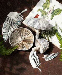 A round up of 24 Altered Books, Folded Books, and Paper Sculptures Made from Books includes this book page paper sculpture of mushrooms and ferns Mushroom Crafts, Mushroom Art, Folded Book Art, Book Folding, Origami, Altered Books, Altered Art, Book Crafts, Paper Crafts