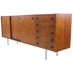 Danish Modern Teak Credenza w / Brushed Steel Legs | From a unique collection of antique and modern credenzas at https://www.1stdibs.com/furniture/storage-case-pieces/credenzas/