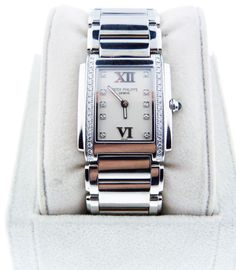 Give Mom some quality  time with this Patek Philippe Ladies Twenty-4 24 SS White Dial Watch