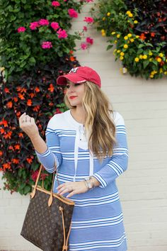Casual summer outfit - click through for more on this cute summer dress paired with a baseball hat! Such a fun summer look. | what to wear on the 4th of july | fourth of july outfit idea | 4th of july outfit inspiration | Casual summer outfit | summer outfit idea | warm weather outfit | fashion blogger outfit | blogger style | how to wear a baseball hat | baseball cap outfit | dad hat outfit | shift dress outfit | summer dress