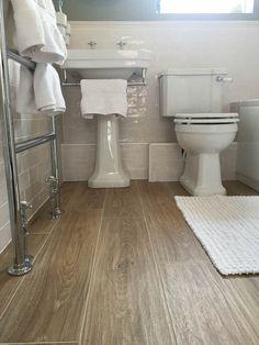 The Aged Oak Wood Porcelain has been used on this bathroom floor to great effect… – Wood Ideas - Badezimmer Ideen Wood Look Tile Bathroom, Vinyl Flooring Bathroom, Basement Flooring, Flooring Ideas, Bathroom Grey, Bath Tiles, Basement Bathroom, Bathroom Faucets, Wood Effect Floor Tiles