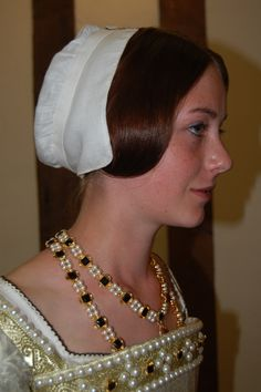 Reproduction example of Tudor beadwork jewellery  along with the beadwork on the typical square neckline