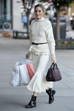 Olivia Palermo wearing Olivia Palermo + Chelsea28 Lace Turtleneck Top, Max&Co. Boston Bag and Dior Rebelle Army Boots