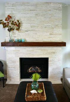 Modern Stone Fireplace Makeover: Before & After :: Hometalk Modern Stone Fireplace, Stone Fireplace Makeover, Fireplace Tile Surround, Fireplace Surrounds, Fireplace Design, Fireplace Makeovers, Modern Fireplaces, Stone Tile Fireplace, Gas Fireplaces