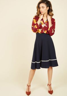 When you don this navy-blue A-line skirt, you channel a winning, smart style! Its knit construction and midi length keep you completely comfortable, while its single yellow ribbon stripe adds a colorful touch to your ensemble.