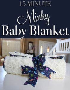 15 Minute Minky Baby Blanket. An easy tutorial to make a soft minky-lined crib blanket, the perfect personal baby shower gift.