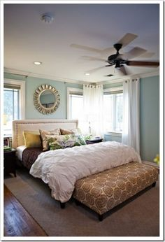 love the white bedding and white curtains with the blue