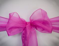 Chair Rentals- Magenta Organza Chair Sash. Complete the look with a matching table runner or napkin. Check out our other fabrics at Eventrentalutah.com or follow our board on Pinterest