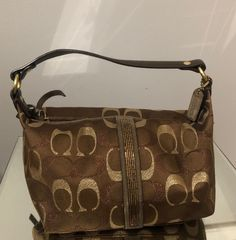 Brown and gold beaded Coach purse. No stains or flaws. Measurements: Width: 7.5 inches Height: 5 inches Vintage Coach, Gold Beads, Coach Purses, Louis Vuitton Damier, Messenger Bag, Satchel, Flaws, Stains