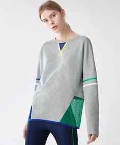 Sweat bonded - Nouveautés - 29.99€ - Sweat gris orné de lignes de couleur. Motifs ajourés dans le bas du dos. - Tendances printemps été 2017 en mode femme chez OYSHO online.