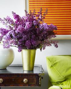 Lilacs from the garden add another burst of color to the room.