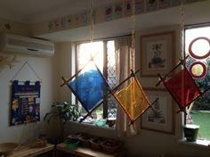 Light catchers hang from twine in the room - This Little Family Daycare ≈≈ http://www.pinterest.com/kinderooacademy/light-shadow-reflection-play/