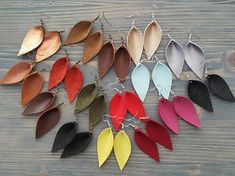 Leather leaf earrings. Small leather earrings. Drop earrings. Bright earrings. Boho earrings. Lightweight earrings. Bohemian earrings. Materials: genuine Italian leather,hypoallergenic hooks, nickel and lead FREE! Length with hooks: 2.75 (7 cm) If you have any questions, please contact