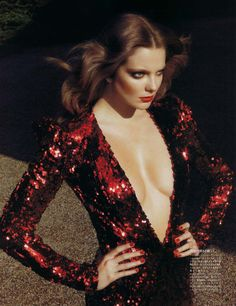 Eniko Mihalik by Camilla Akrans in Red Star   Vogue Nippon August 2010 :: red glitter backdrop + gown