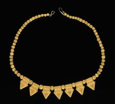 Africa | Gold alloy necklace | Early 20th century | A  woman of high social status would have worn this expertly crafted necklace made by a Moorish master jeweler from Oualata, Mauritania. This small town in southeastern Mauritania has long been recognized as an important center for the fabrication of gold jewelry.