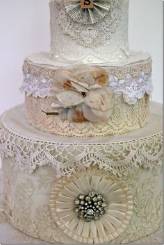 wedding cake (inverted hat boxes) decorated with vintage lace and linens with great old vintage cake topper