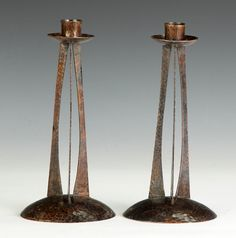 ROYCROFT: Pair of Unusual Hand Hammered Copper Candlesticks. Early 20th cent. 3-arm buttress form. Orb mark on underside. Ht. 9""
