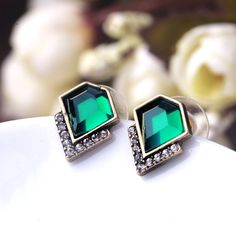 Classic Emerald Crystal Stud Earrings Classic Emerald Crystal Stud Earrings Size : 1.2cmx0.9cm Material : zinc alloy,resin,glass   Brand new !!!!!!! Jewelry Earrings