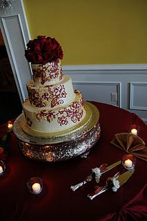 Red and gold wedding cake - I hope it's red velvet inside!