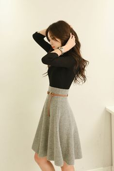 I love everything about this. The fabric and color of the skirt, paired with a simple black top. #KoreanFashion