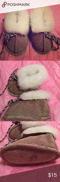 Baby genuine leather furry slippers size 1-6M Genuine Sheepskin and Suede Leather slippers size 1-6 months. Perfect for the winter months ahead, very comfy for baby, easy to slip on and of course super adorable! They are tan accented with fur inside and out. Brand new, never worn with tags! Great deal for high quality!! Old Friend Shoes Slippers