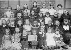 PH/2/233 Black and white photograph showing class group from Sutton Manor National School, St.Helens. c.1898. . . Mrs Helsby was the teacher.PH - Photographic collections 2 - Photographs of buildings in St.Helens and area.