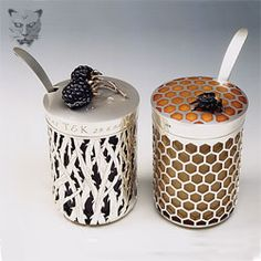 Amazing pierced honey and jam pots with cast berries and bee. Glass liners.  Okay.  Where do I find this?  great for a wedding gift.