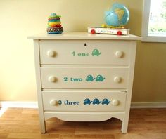 painted white dresser. stenciled turtle nursery. change table. kids room. antique dresser.