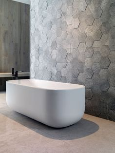 Объемная стена Bathroom Tile Ideas - Grey Hexagon Tiles // These grey hexagonal wall tiles stick out slightly from the wall to create a textured honeycomb look. Best Bathroom Tiles, Bathroom Tile Designs, Modern Bathroom Design, Bathroom Interior, Master Bathroom, Bathroom Ideas, Textured Tiles Bathroom, Bathroom Feature Wall Tile, Feature Tiles