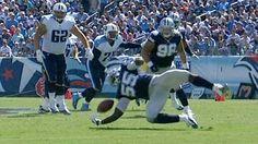 Dallas Cowboys linebacker Rolando McClain intercepts Tennessee Titans quarterback Jake Locker.